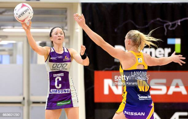 Caitlyn Nevins of the Firebirds passes the ball during the round seven Super Netball match between the Lightning and the Firebirds at University of...