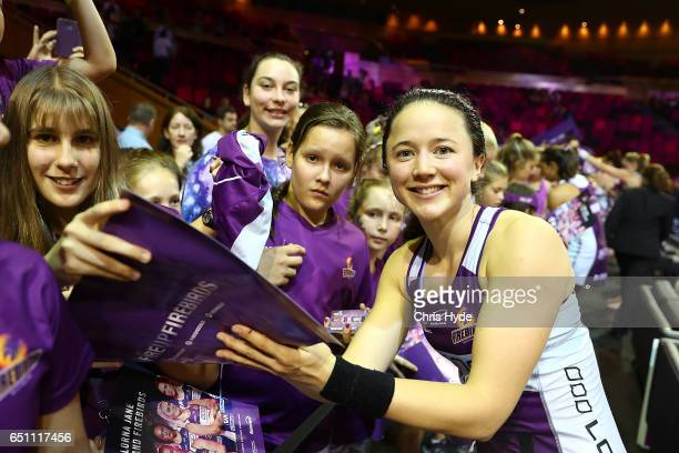 Caitlyn Nevins of the Firebirds signs autographs during the round four Super Netball match between the Firebirds and the Swifts at Brisbane...