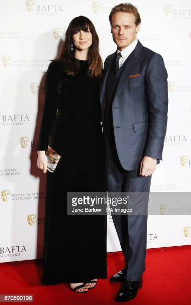 Caitriona Balfe and Sam Heughan arrive for the British Academy Scottish Awards at the Radisson Blu Hotel in Glasgow
