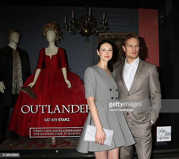 Caitriona Balfe and Sam Heughan attend 'Outlander' and Saks Fifth Avenue Photocall at Saks Fifth Avenue on April 7 2016 in New York City