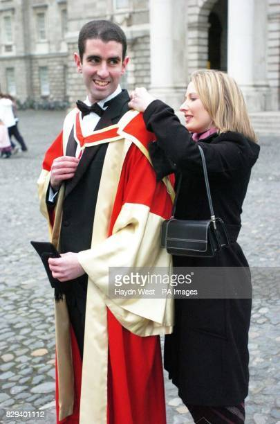 Caitriona Ni Mhurchu adjusts boyfriend Donagh O'Mahony's cape before he picked up his graduation certificate for a PHD in Physics at Trinity College...