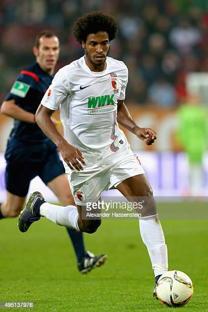 Caiuby Francisco da Silva of Augsburg battles for the ball during the Bundesliga match between FC Augsburg and 1 FSV Mainz 05 at WWK Arena on October...