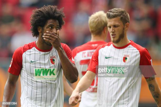 Caiuby of Augsburg and Jeffrey Gouweleeuw of Augsburg look dejected during the Bundesliga match between FC Augsburg and Borussia Dortmund at WWKArena...