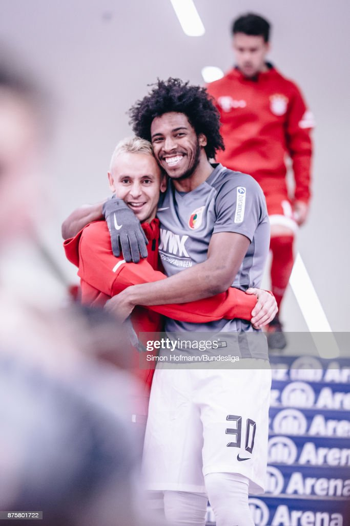 Caiuby of Augsburg hugs Rafinha of Muenchen in the tunnel during the Bundesliga match between FC Bayern Muenchen and FC Augsburg at Allianz Arena on November 18, 2017 in Munich, Germany.