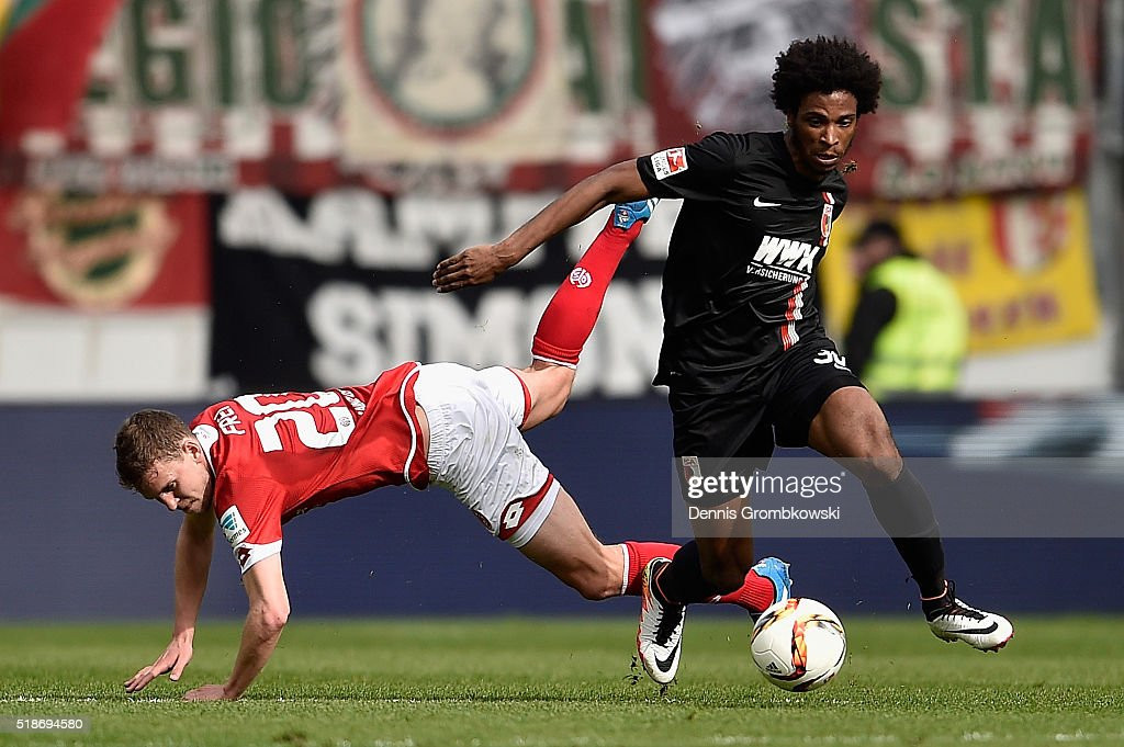 Caiuby of FC Augsburg is challenged by <a gi-track='captionPersonalityLinkClicked' href=/galleries/search?phrase=Fabian+Frei&family=editorial&specificpeople=4783637 ng-click='$event.stopPropagation()'>Fabian Frei</a> of 1. FSV Mainz 05 during the Bundesliga match between 1. FSV Mainz 05 and FC Augsburg at Coface Arena on April 2, 2016 in Mainz, Germany.