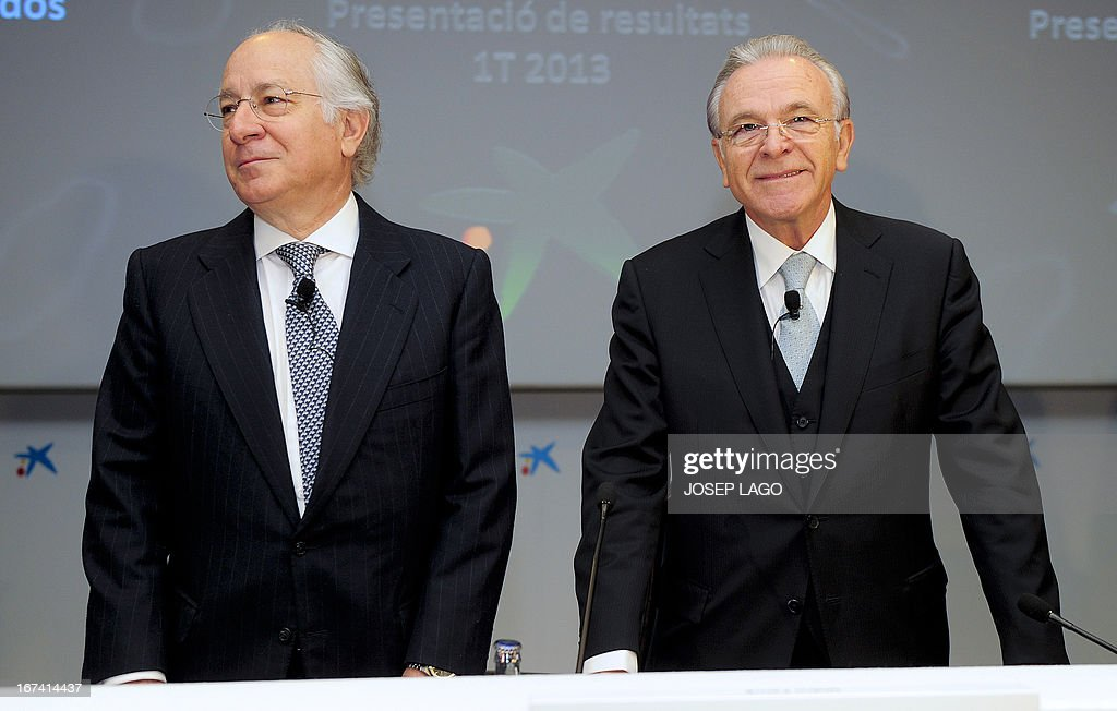 CaixaBank's president Isidro Faine (R), and CaixaBank's General Director Juan Maria Nin (L) pose during a press conference in Barcelona on April 25, 2013, to present the company's results for the first three months of 2013. CaixaBank, Spain's biggest bank as measured by assets under management, announced today a first-quarter net profit multiplied by seven compared with the same period last year, to 335 million euros, following recent acquisitions. AFP PHOTO / JOSEP LAGO