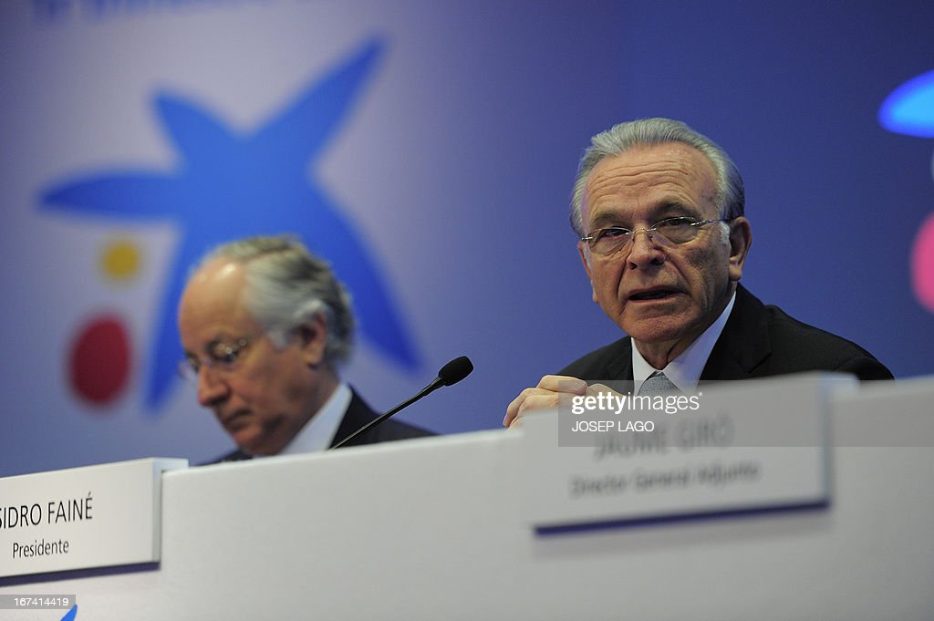 CaixaBank's president Isidro Faine (R) speaks during a press conference in Barcelona on April 25, 2013, to present the company's results for the first three months of 2013. CaixaBank, Spain's biggest bank as measured by assets under management, announced today a first-quarter net profit multiplied by seven compared with the same period last year, to 335 million euros, following recent acquisitions.