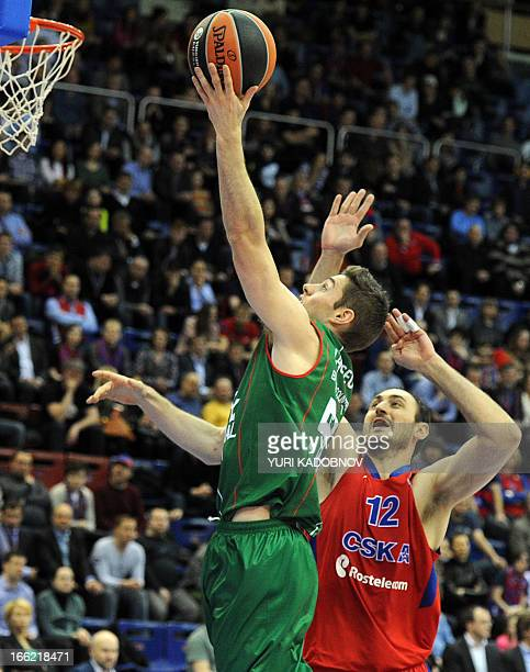 Caja Laboral's guard Fabien Causeur vies with CSKA Moscow's center Nenad Krstic during the Euroleague play off first leg basketball match in Moscow...