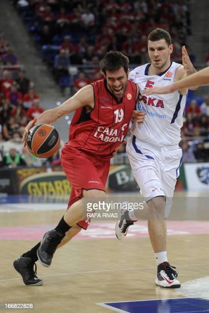 Caja Laboral's guard Fernando San Emeterio vies with CSKA Moscow's forward Alexander Micov during a Euroleague basketball playoffs match Caja Laboral...