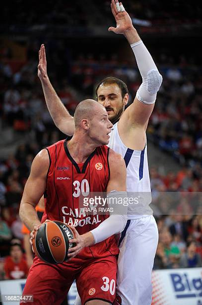 Caja Laboral's Polish center Maciej Lampe vies with CSKA Moscow's Serbian centre Nenad Krstic during a Euroleague basketball playoffs match Caja...