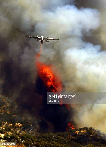 Cajon Pass Sept 08 2004 ––– An airplane drops fire retardant on the Runaway Fire near Highway 138 Wednesday The blaze which was started by a vehicle...