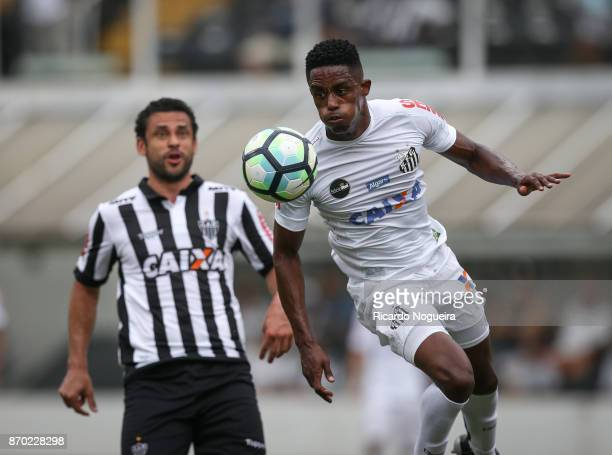 Caju of Santos battles for the ball with Fred of Atletico Mineiro during the match between Santos and Atletico Mineiro as a part of Campeonato...