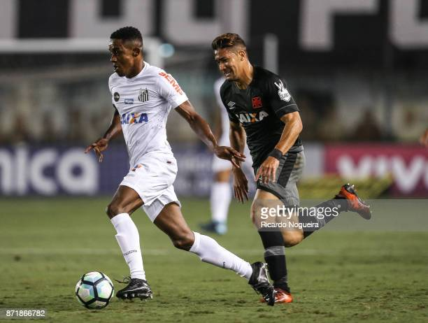 Caju of Santos battles for the ball with Jean of Vasco during the match between Santos and Vasco da Gama as a part of Campeonato Brasileiro 2017 at...