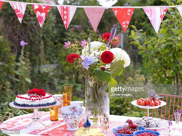 Cake and flowers on table ready for children party