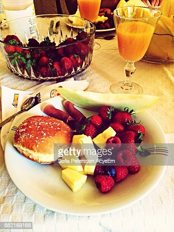 Cake And Fruits On Table Ready To Eat, Orange Juice In Glass