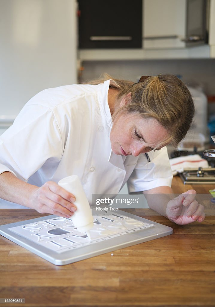 Cake baker icing letters to decorate : Stock Photo