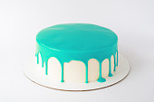 Cake baking with cyan glaze on white background. Picture for a menu or a confectionery catalog.