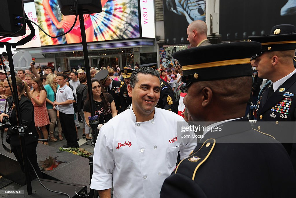 'Cake Boss' reality show baker <a gi-track='captionPersonalityLinkClicked' href=/galleries/search?phrase=Buddy+Valastro&family=editorial&specificpeople=5810322 ng-click='$event.stopPropagation()'>Buddy Valastro</a> thanks soldiers after attending a ceremony in Times Square marking the U.S. Army's 237th anniversary on June 14, 2012 in New York City. U.S. Army Chief of Staff Gen. Raymond Odierno cut Valastro's 500 pound cake before swearing in16 new recruits during the event. Valastro said eight of his staff spent three days preparing the giant cake in the shape of a tank.