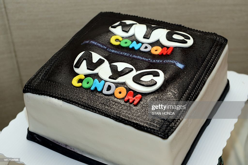 A cake decorated to look like a NYC Condom during a program to announce 'NYC Condom: A Retrospective Exhibit' at New York University and National Condom Awareness Week February 15, 2013 in New York. Since 1971 the New York City Health Department has been providing free male condoms and introduced the country's first branded condom, the 'NYC Condom', on National Condom Awareness Day 2007. AFP PHOTO/Stan HONDA