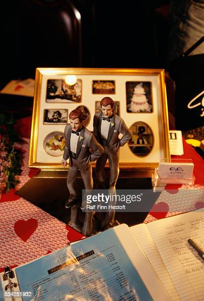 Cake decorations in the form of two grooms and other wedding items stand on display at a gay and lesbian wedding fair in Chicago Participants at the...