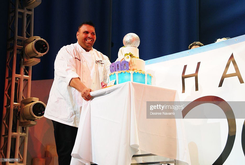 Cake decorator/TV personality Frankie Amato brings out the cake on stage during curtain call at the 5,000 performance celebration of 'Mamma Mia!' on Broadway at Broadhurst Theatre on November 9, 2013 in New York City.
