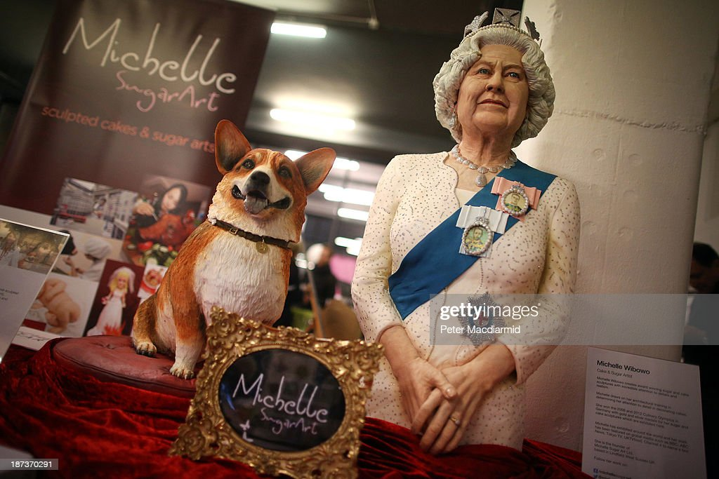 A cake depicting Queen Elizabeth II and a corgi dog made by cake and sugar artist Muchelle Wibowo is shown at the Experimental Food Society Exhibition on November 8, 2013 in London, England. A collective of food magicians, sonic food artists, cake sculptors, gastronomic tailors, culinary cabaret troupes and a dining conceptualist have gathered together for a two day exhibition featuring their unique edible creations.