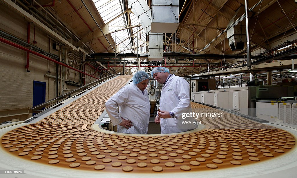 Cake Design and Development Head chef Paul Courtney (R) and Manufacturing Manager Tom Kilcourse perform a quality check on biscuits on the production line at the McVitie's factory March 25, 2011 in Stockport, England. Prince William has asked McVitie's to create one of his favourite sweet treats to provide an alternative to the official wedding cake by Fiona Cairn. The wedding will take place on April 29, 2011.