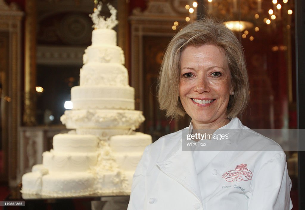 Cake designer Fiona Cairns poses with the Duke and Duchess of Cambridge's royal wedding cake as it is photographed before it goes on display at Buckingham Palace during the annual summer opening on July 20, 2011 in London, England. The cake was featured in the wedding of Catherine, Duchess of Cambridge to Prince William, Duke of Cambridge on April 29.