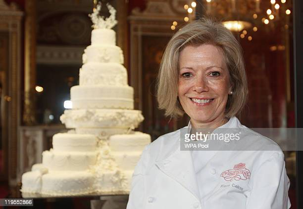 Cake designer Fiona Cairns poses with the Duke and Duchess of Cambridge's royal wedding cake as it is photographed before it goes on display at...