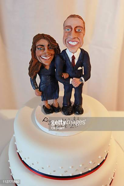 A cake featuring figurines of Prince William and Kate Middleton is displayed at an exhibition of Royal Wedding cakes on April 21 2011 in London...