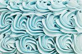 Blue cake icing swirl decoration background pattern.