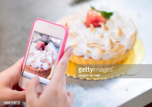 Cake in mobile phone : Stock Photo