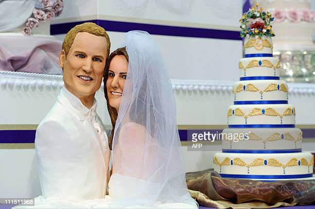A cake made by Michelle Wibowo representing Prince William and his fiance Kate Middleton is on display at the Ideal Home Show exhibition in central...