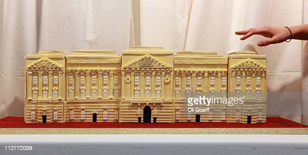 A cake of Buckingham Palace is displayed at an exhibition of Royal Wedding cakes on April 21 2011 in London England The cake features in the 'Let...