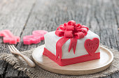 Cake Of Ribbon Box on wood background