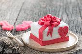 Cake Of Ribbon Box on wood background