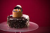 cake on glass plate on red background