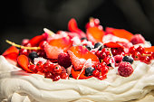 Cake Pavlova with cream and fresh fruits.