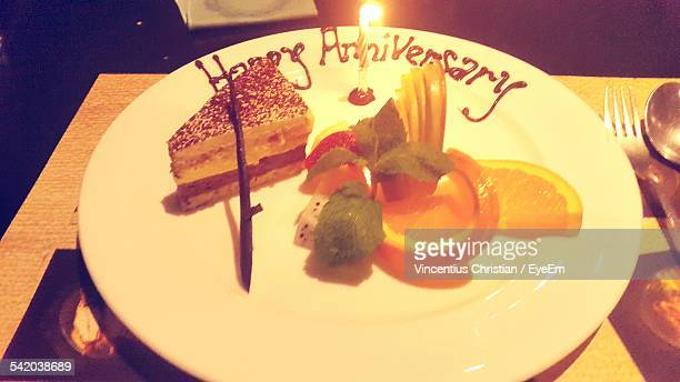 Cake Slice In Plate Garnished For Anniversary On Table