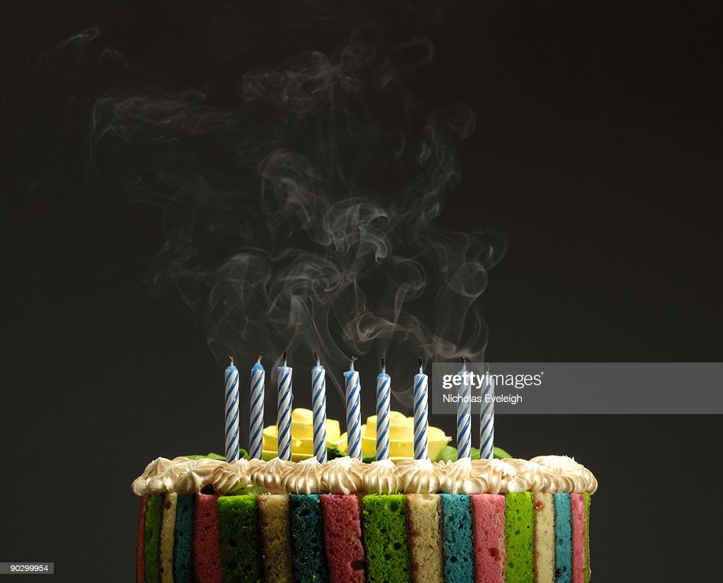 Cake with burnt candles : Stock Photo