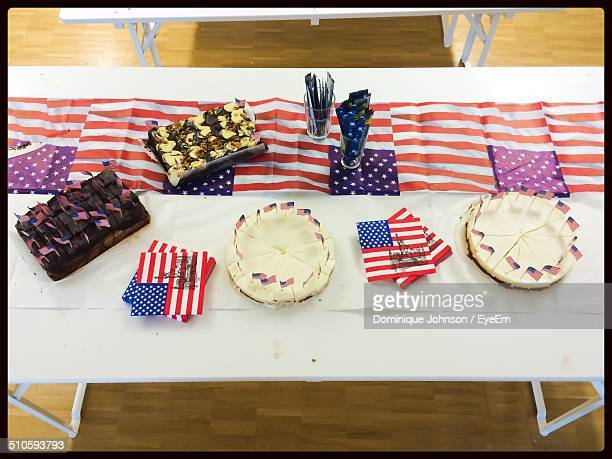 Cakes and brownies on table with American flags