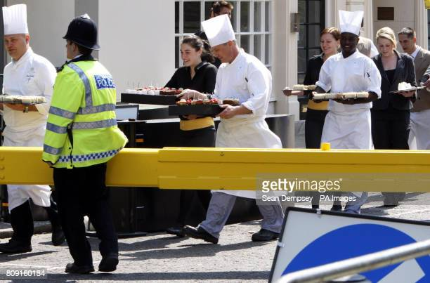 Cakes and sandwiches are carried by members of staff from the Goring Hotel in London to members of the press ahead of the Royal Wedding between...