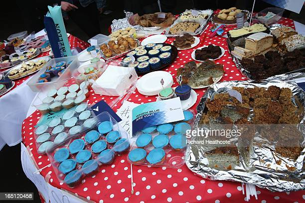 Cakes are sold prior to the BNY Mellon 159th Oxford versus Cambridge University Boat Race on The River Thames on March 31 2013 in London England