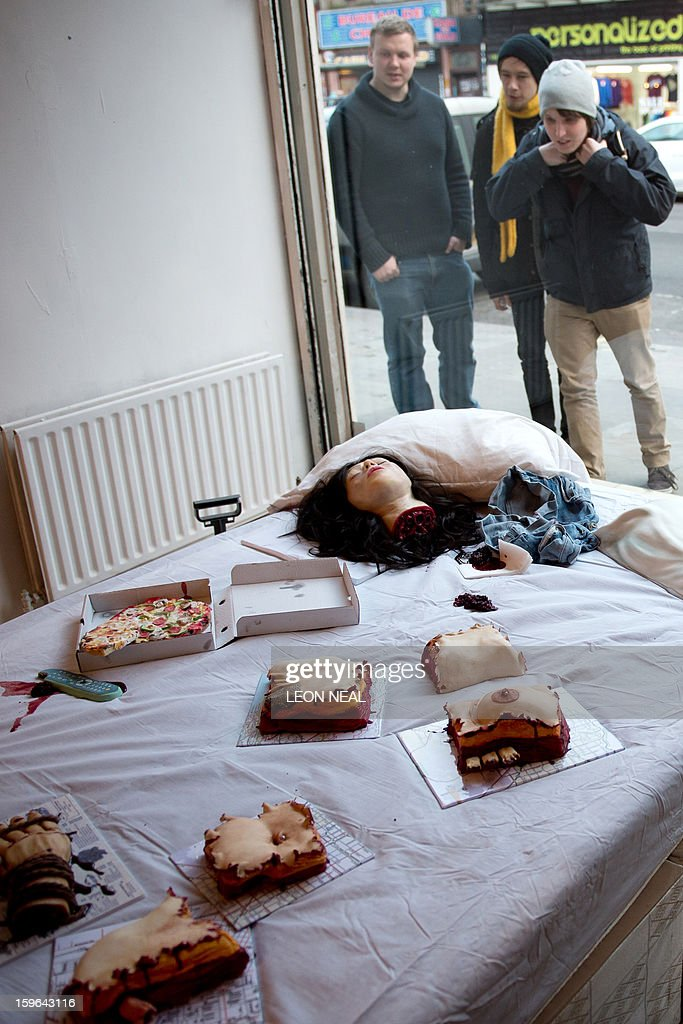 Cakes in the shapes of severed limbs and body parts made from entirely edible ingredients are displayed at a film set pop-up experience in east London on January 17, 2013. The event was held to promote the release of a new horror film 'The Helpers'.