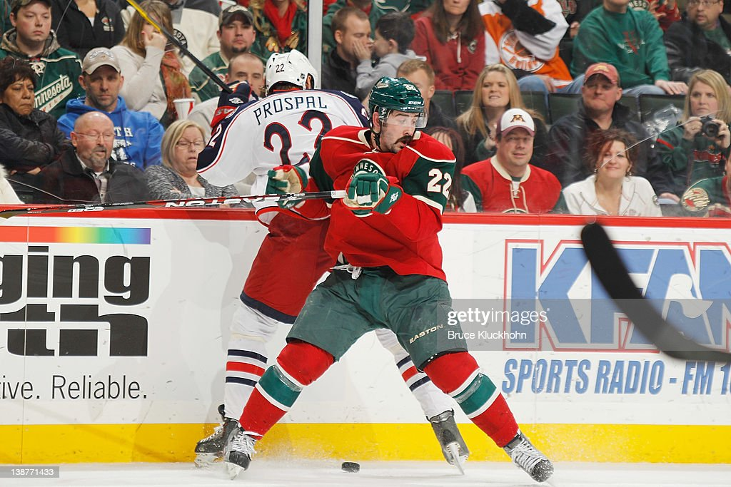 <a gi-track='captionPersonalityLinkClicked' href=/galleries/search?phrase=Cal+Clutterbuck&family=editorial&specificpeople=570497 ng-click='$event.stopPropagation()'>Cal Clutterbuck</a> #22 of the Minnesota Wild and Vinny Prospal #22 of the Columbus Blue Jackets battle for control of the puck during the game at the Xcel Energy Center on February 11, 2012 in St. Paul, Minnesota.