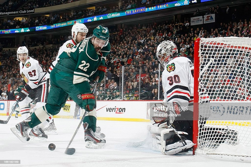 <a gi-track='captionPersonalityLinkClicked' href=/galleries/search?phrase=Cal+Clutterbuck&family=editorial&specificpeople=570497 ng-click='$event.stopPropagation()'>Cal Clutterbuck</a> #22 of the Minnesota Wild attempts to score but is denied by goalie <a gi-track='captionPersonalityLinkClicked' href=/galleries/search?phrase=Ray+Emery&family=editorial&specificpeople=218109 ng-click='$event.stopPropagation()'>Ray Emery</a> #30 of the Chicago Blackhawks during the game on April 9, 2013 at the Xcel Energy Center in Saint Paul, Minnesota.