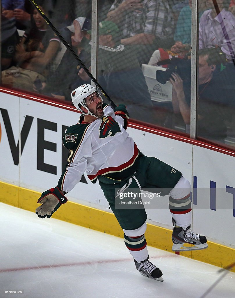 <a gi-track='captionPersonalityLinkClicked' href=/galleries/search?phrase=Cal+Clutterbuck&family=editorial&specificpeople=570497 ng-click='$event.stopPropagation()'>Cal Clutterbuck</a> #22 of the Minnesota Wild celebrates after scoring a 1st period goal against the Chicago Blackhawks over the boards while trying to control the puck in Game One of the Western Conference Quarterfinals during the 2013 NHL Stanley Cup Playoffs at the United Center on April 30, 2013 in Chicago, Illinois.