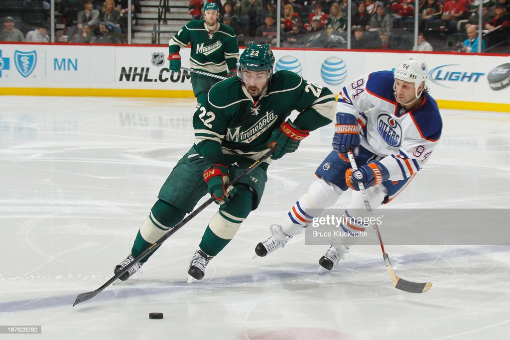 <a gi-track='captionPersonalityLinkClicked' href=/galleries/search?phrase=Cal+Clutterbuck&family=editorial&specificpeople=570497 ng-click='$event.stopPropagation()'>Cal Clutterbuck</a> #22 of the Minnesota Wild skates with the puck while <a gi-track='captionPersonalityLinkClicked' href=/galleries/search?phrase=Ryan+Smyth+-+Ice+Hockey+Player&family=editorial&specificpeople=202567 ng-click='$event.stopPropagation()'>Ryan Smyth</a> #94 of the Edmonton Oilers defends during the game on April 26, 2013 at the Xcel Energy Center in St. Paul, Minnesota.
