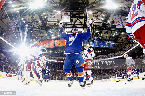 Cal Clutterbuck of the New York Islanders celebrates a goal by Matt Martin of the New York Islanders at Nassau Veterans Memorial Coliseum on January...