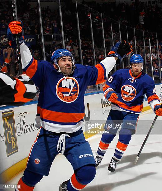 Cal Clutterbuck of the New York Islanders celebrates his goal at 340 of the second period against the New York Rangers as he is joined by Michael...